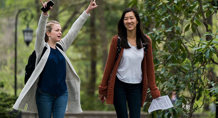 Wellesely College students celebrate as they walking in an academic quad