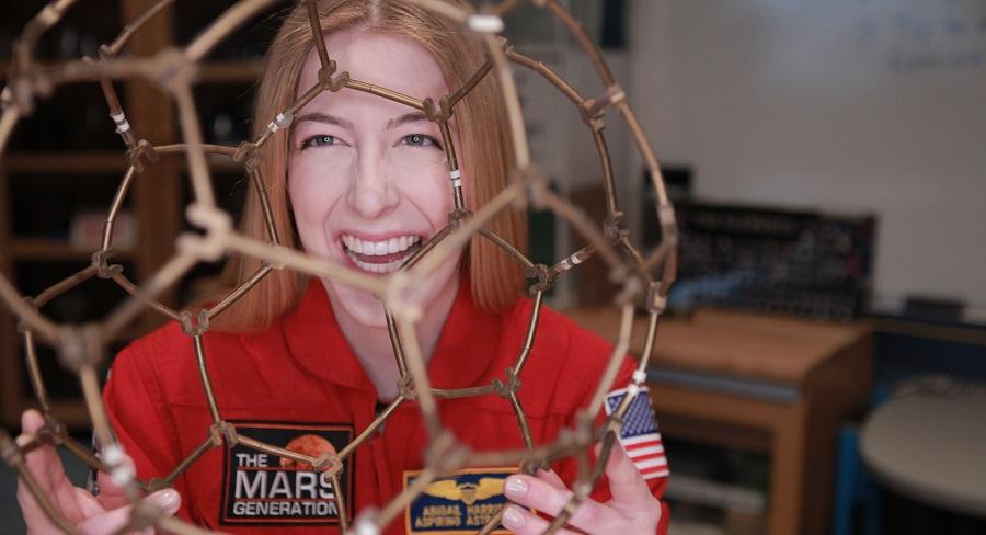 Wellesley College student, Abby Harrison, known as Astronaut Abby, poses for a photo for the 501(c)(3) nonprofit that she founded, The Mars Generation