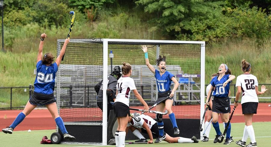 Wellesley College field hockey player, Arielle Mitropolis, celebrates with her teammates after scoring a goal.