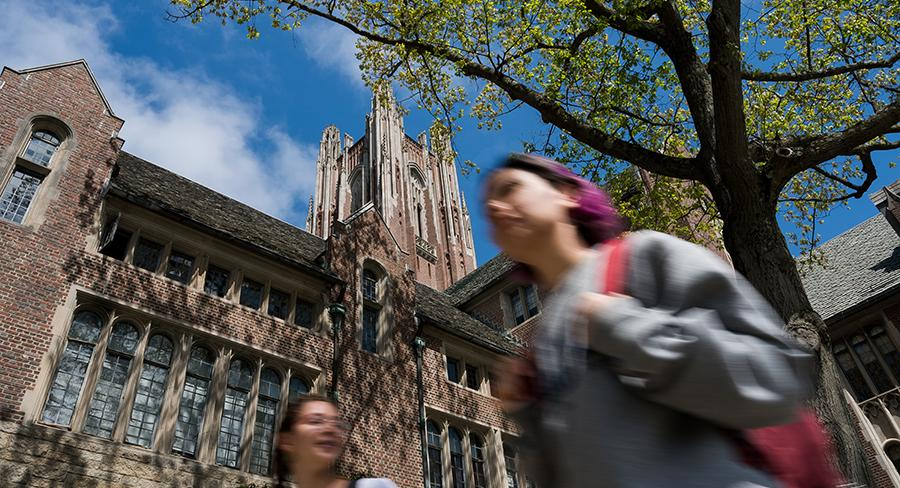 Two college students walk through Wellesley College academic quad