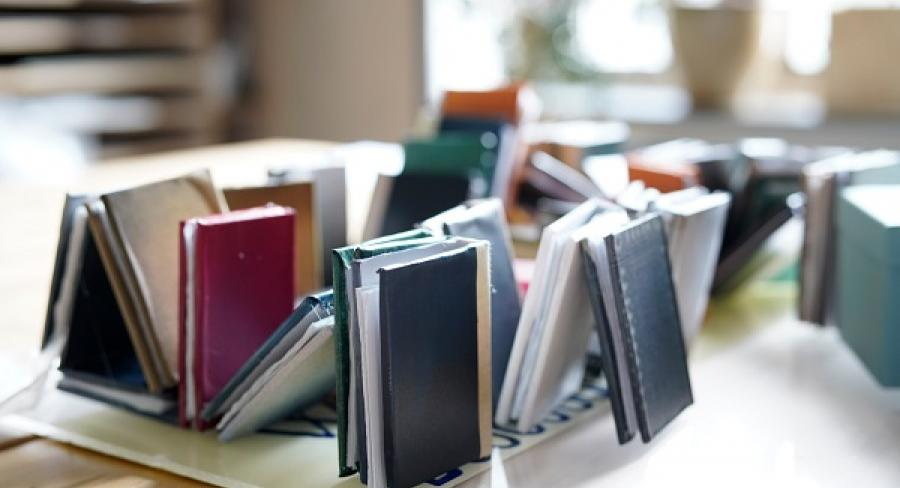 Books sit on a table in the Wellesley Clapp Library
