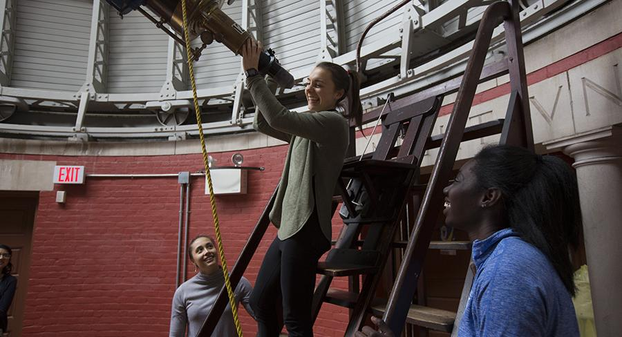 Wellesley students use a telescope in the Whitin Observatory