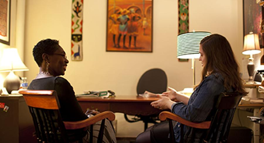 Angela C. Carpenter, Associate Professor of Cognitive and Linguistic Sciences at Wellesley College, talks with a student