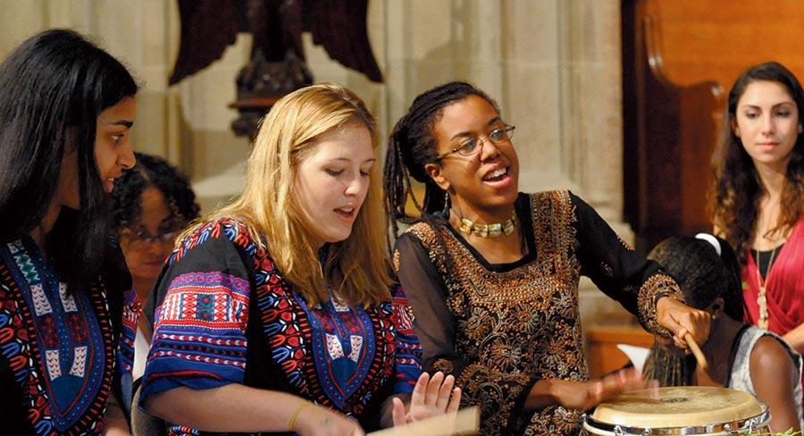 Two Wellesley College students play drums as part of Yanvalou Drum & Dance Ensemble, a group that performs the folkloric music and dance of Africa